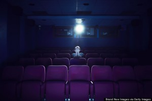 Man watching a movie in empty cinema